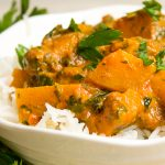 squash curry over rice in bowl p1