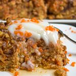 piece of baked carrot cake oatmeal on plate with sour cream and syrup p