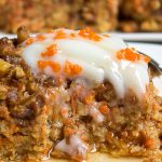 piece of baked carrot cake oatmeal on plate with sour cream and syrup p1