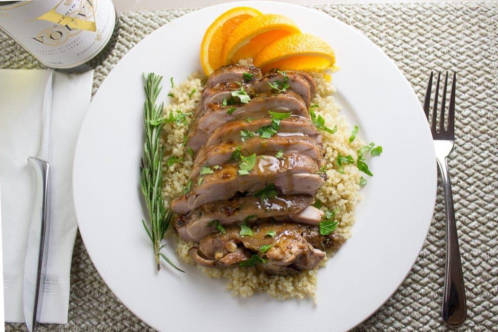 sliced Sous Vide Turkey on plate over quinoa