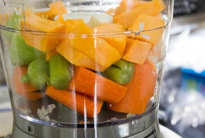 cubed vegetables in processor bowl
