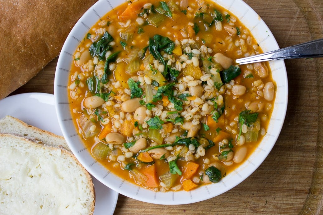 Vegetable Bean and Barley Soup in bowl with bread and butter 1