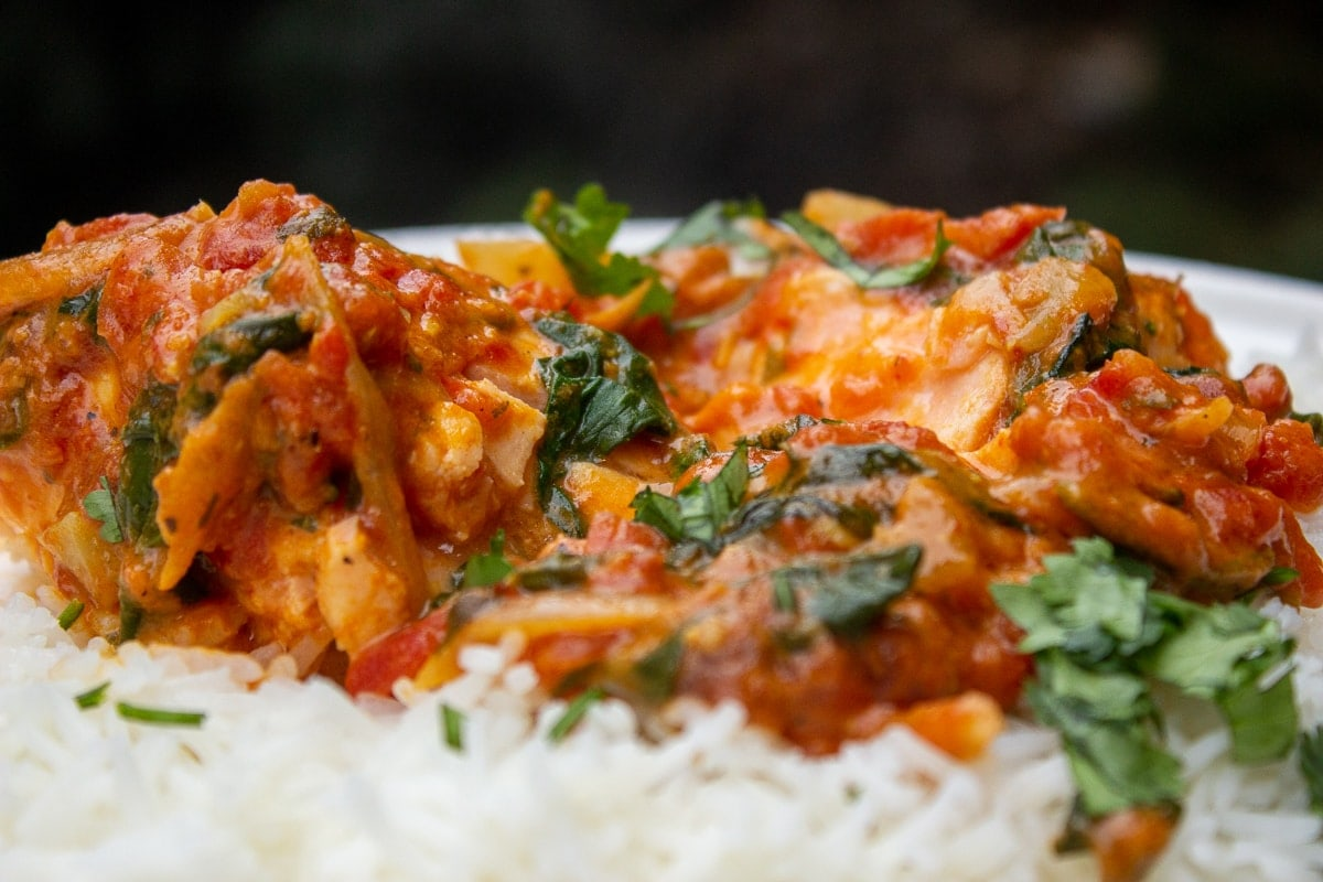 coconut curry salmon over rice in on plate