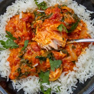 Coconut Curry Salmon over rice in a bowl ff