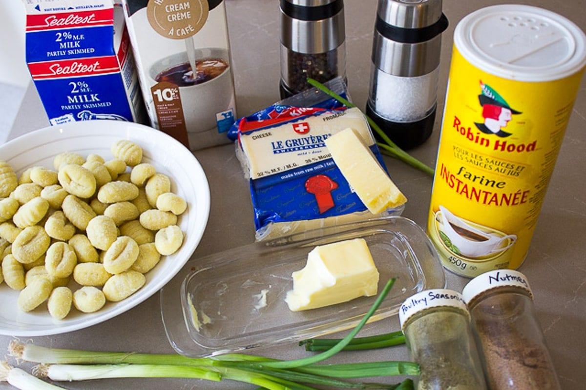 gnocchi, butter, cheeses, milk, cream, seasonings, flour, green onions