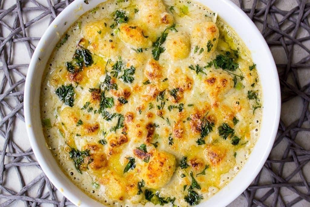 baked gnocchi au gratin in casserole dish
