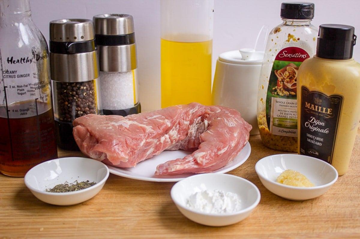 pork tenderloin, grainy mustard, dijon, maple syrup, seasonings, cornstarch, oil, garlic