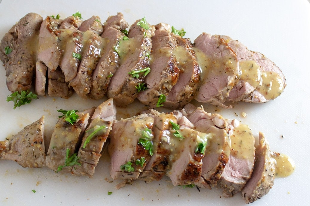 sous vide maple mustard pork tenderloin on cutting board 5