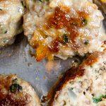 all-purpose Italian meatballs baked on pan. one cut open p1
