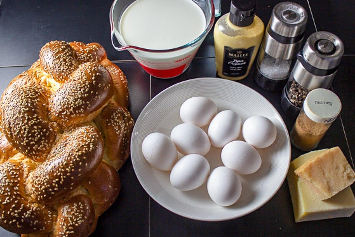bread, eggs, milk/cream, Dijon, salt, pepper, nutmeg, cheeses