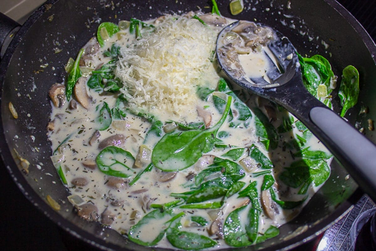spinach and cheese added to mushroom onion sauce
