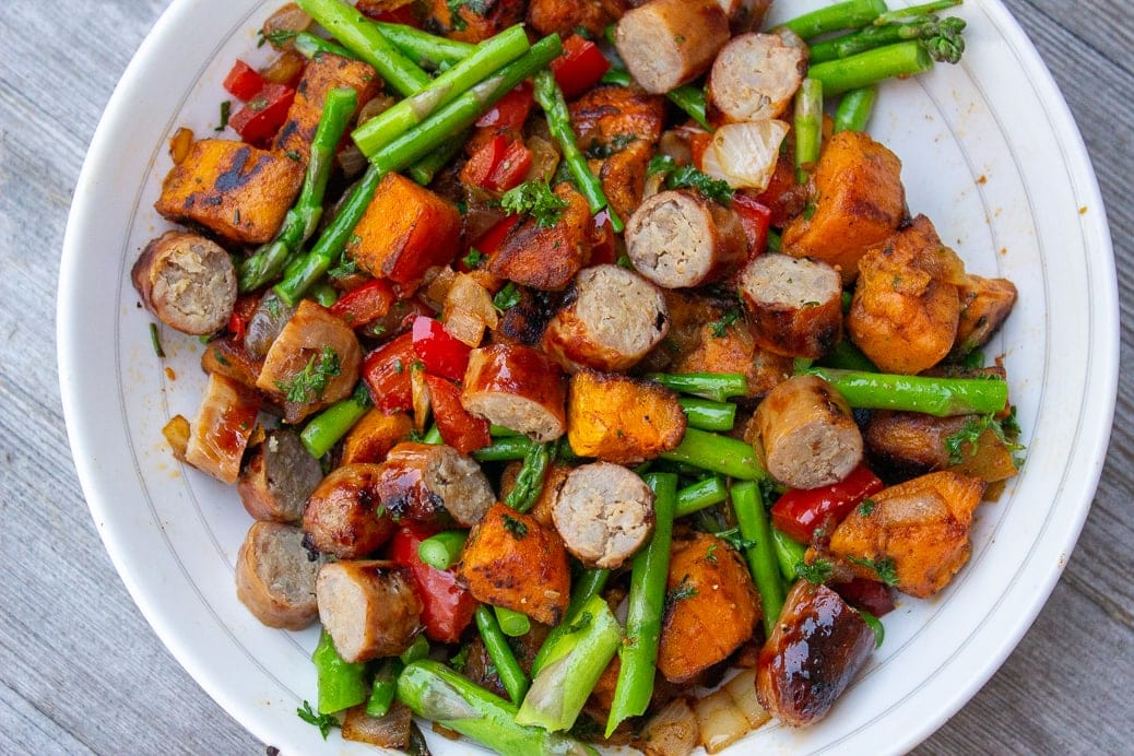 vegetarian sweet potato hash with sausage and asparagus in a bowl x