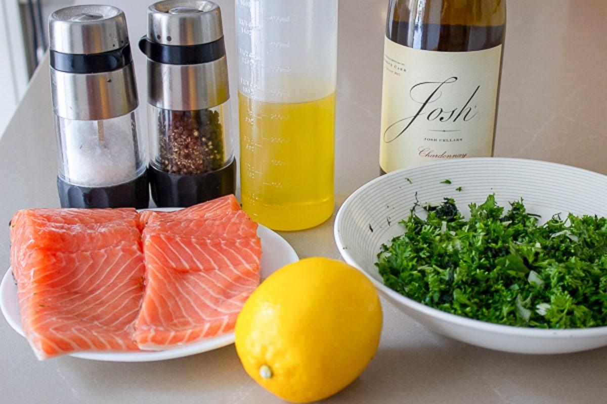 salmon fillets, oil, wine, herbs, lemon, salt, pepper