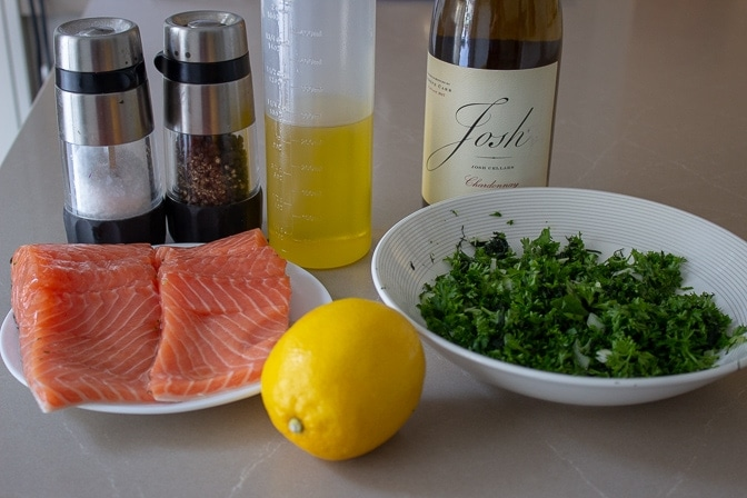 Ingredients for Roasted Salmon Stuffed With Herbs - salmon, herbs, lemon, olive oil, salt, pepper