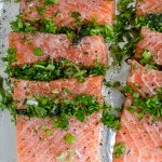 two raw close up of fillet of oasted Salmon Stuffed With Herbs on pan ready to bake p
