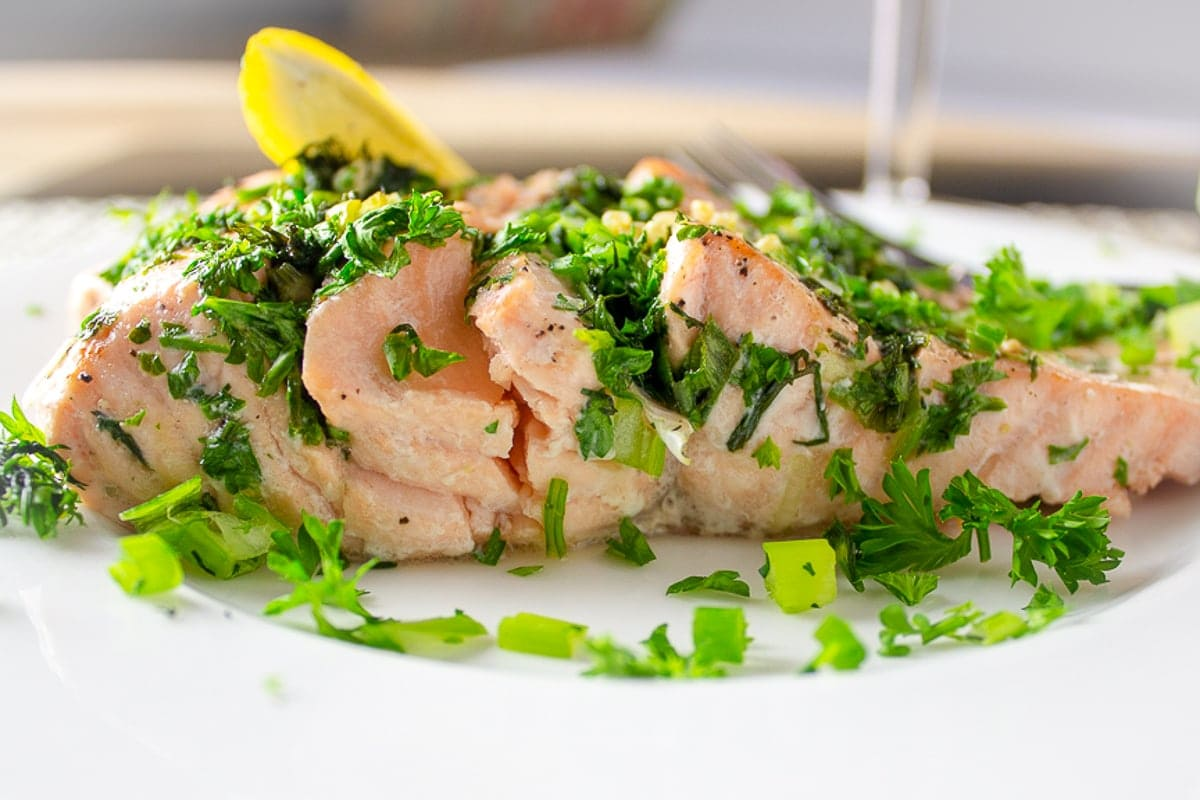 Roasted Salmon Stuffed With Herbs on a plate f