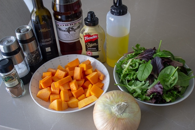ingredients squash, oil, salad, onions, white balsamic vinegar, dijon, mustard for Butternut Squash Salad with Warm Cinnamon Dressing