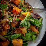 Butternut Squash Salad with Warm Cinnamon Dressing in a bowl p