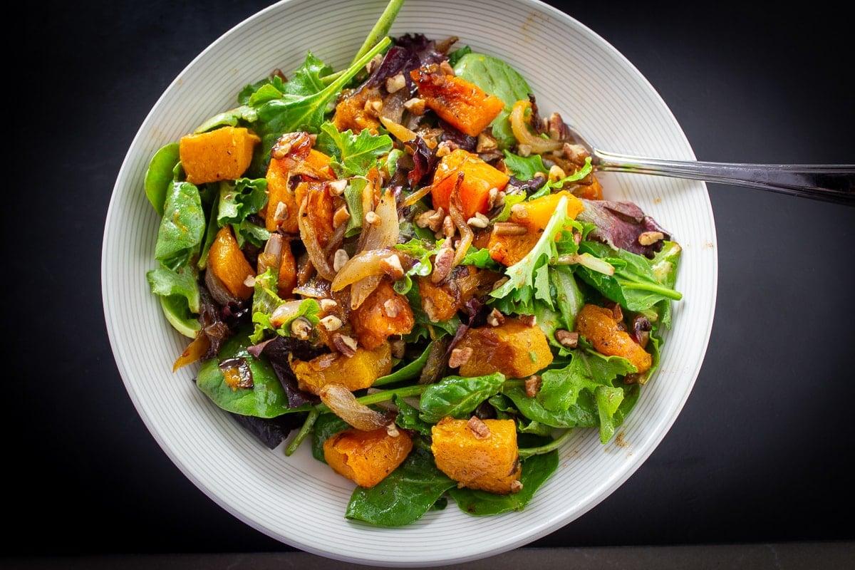 Butternut Squash Salad with Warm Cinnamon Dressing in a bowl 8