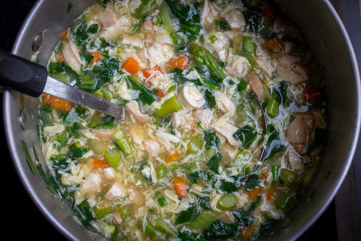 vegetable egg drop soup in pot with chicken
