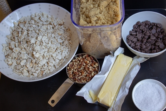 Matzo Crack ingredients on table - matzo, brown sugar, butter, pecans, salt, chocolate chips