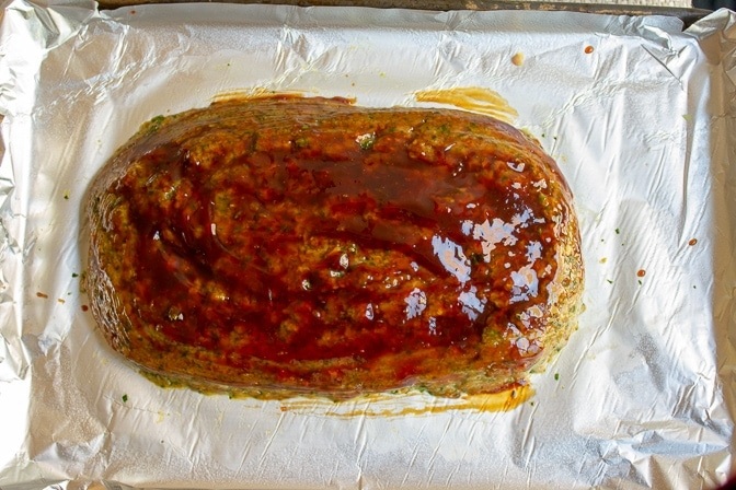 chicken meatloaf with glaze topping on pan ready to bake