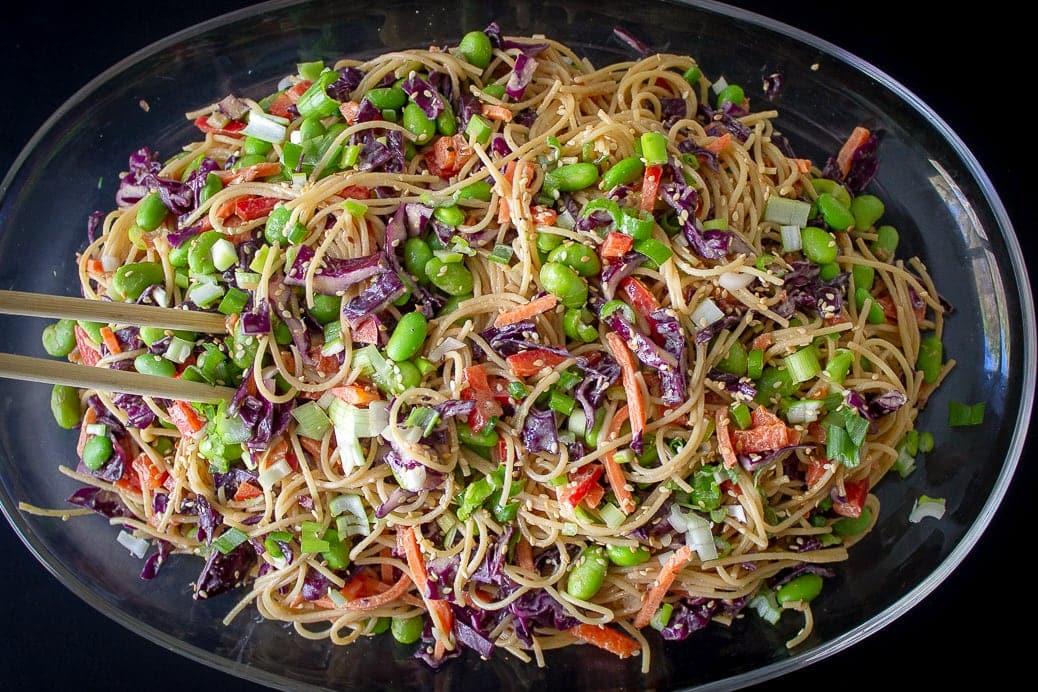 Peanut Noodles with Vegetables on glass platter