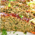 slices of chicken and vegetable meatloaf on plate with coleslaw p