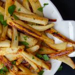 honey roasted parsnips in a bowl