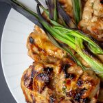 Grilled Vietnamese Chicken on plate with grilled scallions