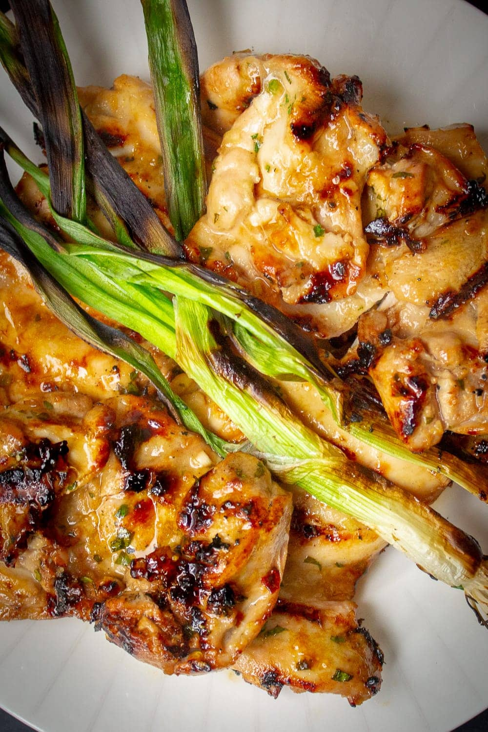 Grilled Vietnamese Chicken with grilled green onion on plate pp