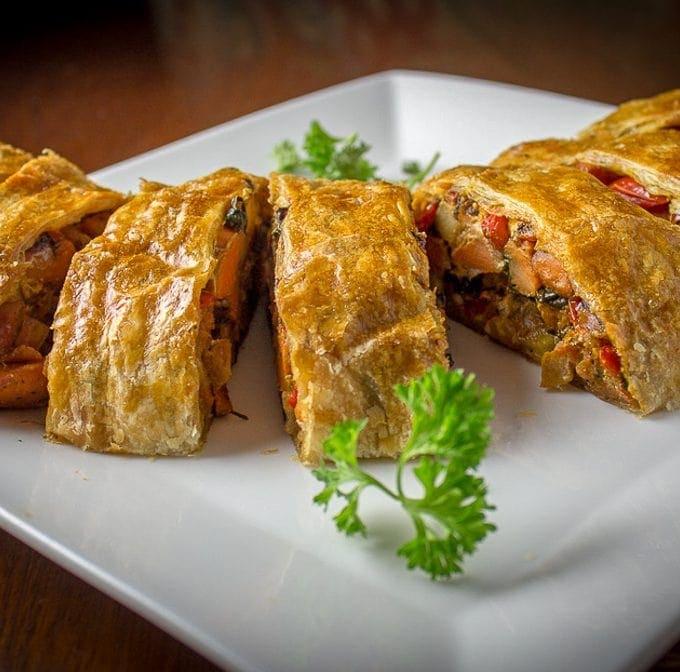 Sliced vegetable strudel in serving plate