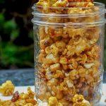 homemade caramel popcorn in glass jar