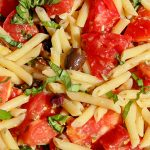 Fresh tomato pasta with lemon and olives in a serving bowl p2