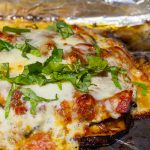 Eggplant Parmesan in baking pan after grilling on bbq