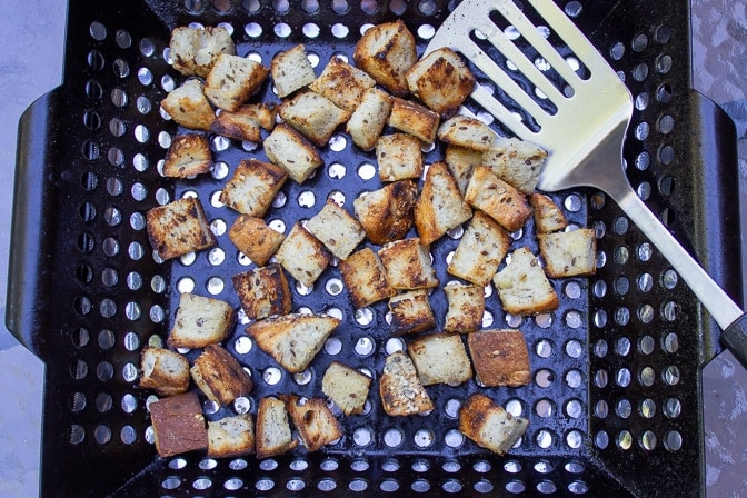 bread cubes grilled in a grill basket