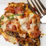 piece of Eggplant Parmesan on plate with fork p6