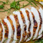 sliced grilled turkey breast on cutting board