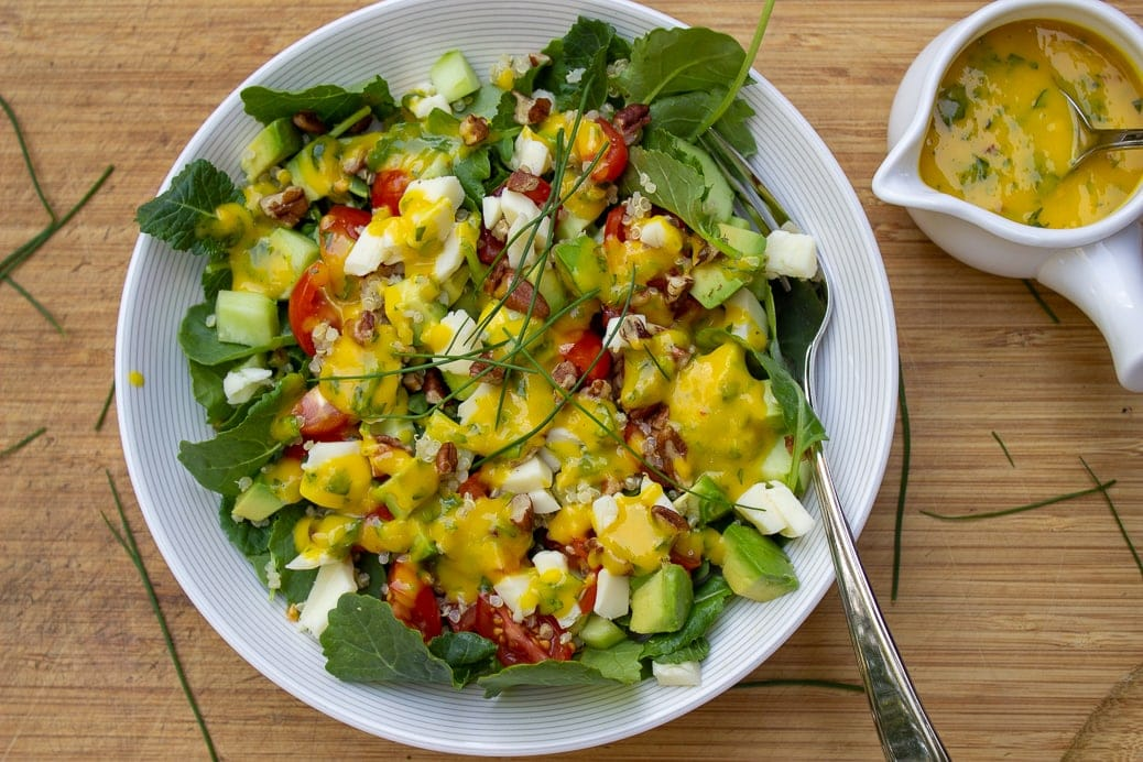 Mango Salad Dressing on salad with dressing in cup on the side2