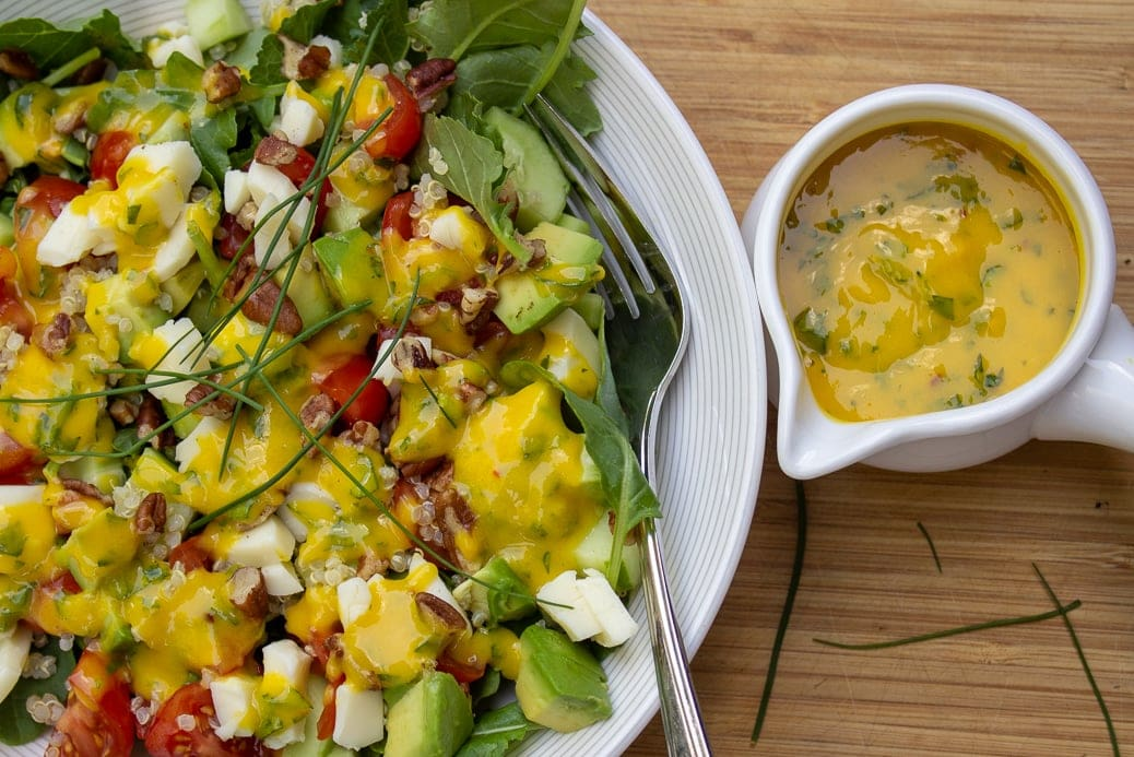 Mango Salad Dressing on salad with dressing in cup on the side