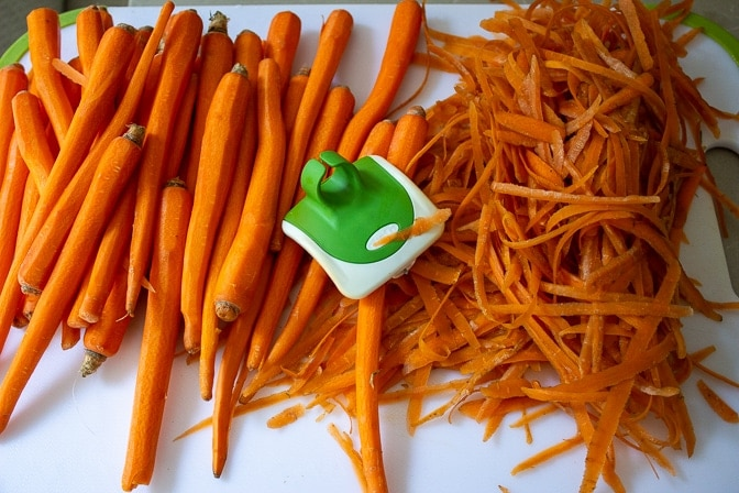 carrots and peelings on cutting board