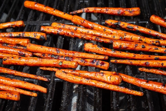 glazed parboiled carrots grilling on grill