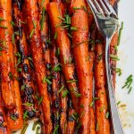 Grilled Carrots with Balsamic Glaze on a plate with a serving fork p1