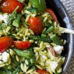 Pesto Orzo and Vegetables in bowl on placemat