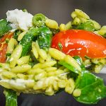 pesto orzo and vegetables on a spoon p1