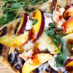grilled pizza on cutting board p1