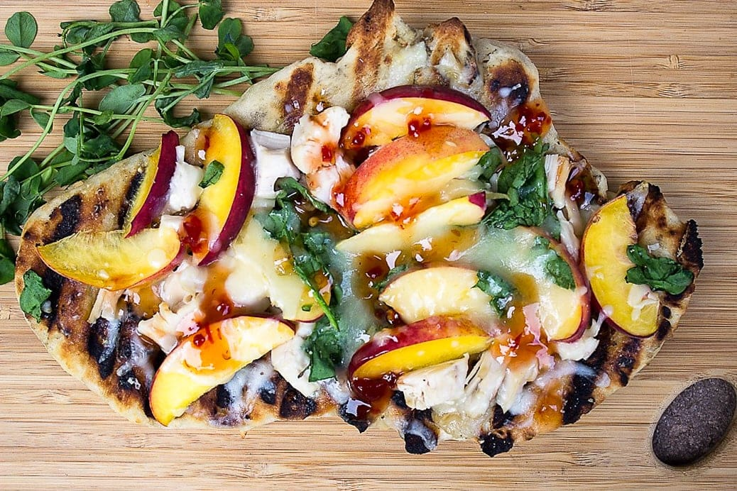 grilled pizza on cutting board