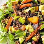 red quinoa salad with roasted carrots on a serving platter p