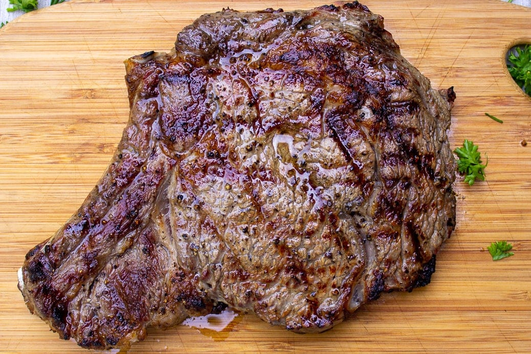 grilled steak on cutting board