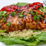 ceder planked salmon on bed of quinoa and spinach with grilled peppers p